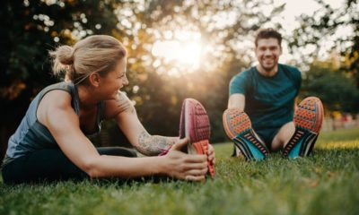couple stretching | 6 Resolution Ideas for a New You in 2020 | Featured