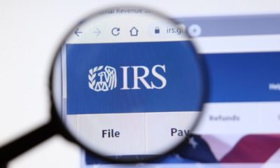 IRS Logo on Display Screen | IRS Allows Employers to Let Workers Make Midyear Changes to Health Plans | Featured
