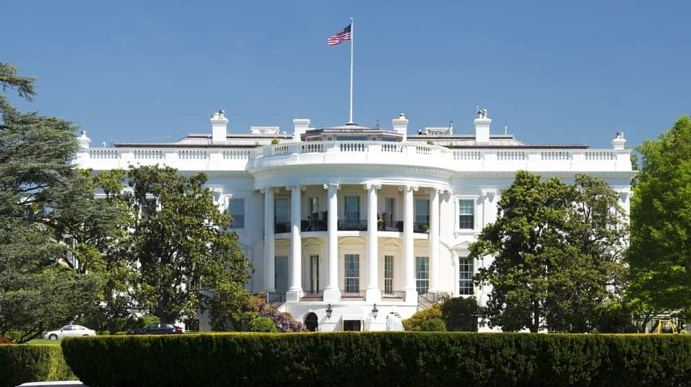 White House on Deep Blue Sky Background | White House Butler Who Served 11 Presidents Dies of COVID-19 | Featured