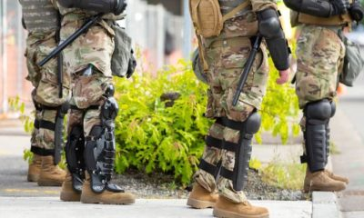Faceless National Guard soldiers wearing body riot gear | Trump Orders Withdrawal of National Guard from Washington | Featured