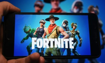 "Hand Holding Phone with Fortnite Logo Displayed in it | ""Fortnite"" Removes Police Cars in New Update 