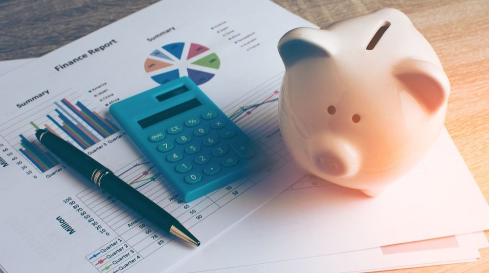 Piggy Bank with Business Stuff | Study Shows That Less Than Half of Americans Are Worried About Money Despite COVID-19 Pandemic | Featured