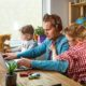 Man Works on Laptop with Children Playing Around | COVID-19 Pandemic Causes Americans to Struggle in Achieving Work-Life Balance | Featured