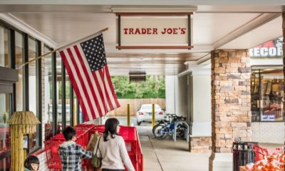 Trader Joes Grocery Store Entrance with Sign | Trader Joe's Says Its Product Names Aren't Racist, Won't Make a Change: Reports | Featured