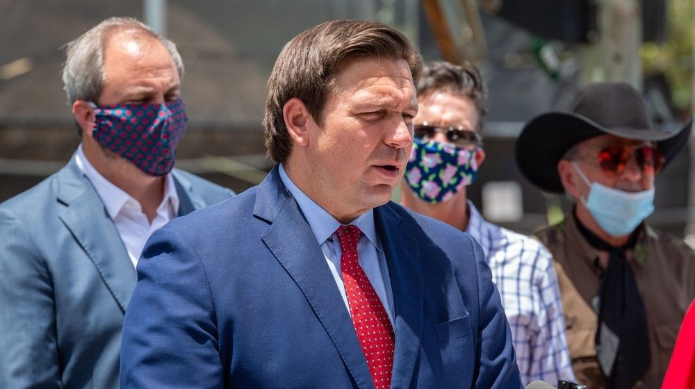 Governor Florida Ron DeSantis with Casey DeSantis and Madison DeSantis | Gov. Ron DeSantis: Feds Should Loosen Travel Restrictions | Featured