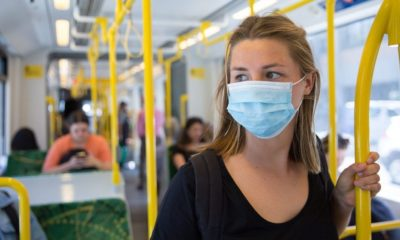 Young Woman Wearing a Face Mask Riding Public Transport | Recent Study Finds That Younger Generations Are More Likely to Lose Their Health Coverage Due to Pandemic | Featured