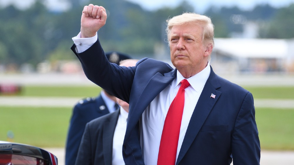 President Donald Trump gives a fist pump arriving at Dobbins Air Reserve Base-trump leaving white house-ss-featured