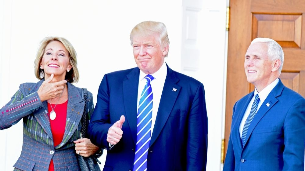 Betsy DeVos with President Trump and Vice President Pence-DeVos Tell Staffers- Resist Changes Under Biden-ss-Featured