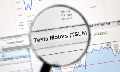 Tesla Motors stock market ticker with charts under magnifying glass-Tesla Enters S&P 500-ss-featured
