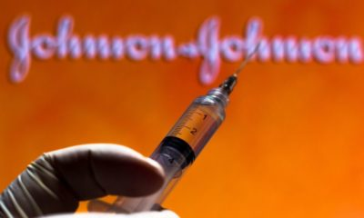 Syringe and Johnson & Johnson logo in the background-Johnson & Johnson One-Shot Vaccine Information Here-ss-Featured