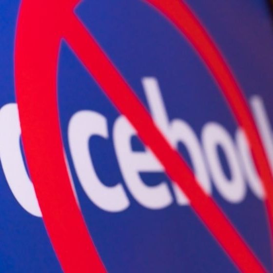 Facebook logo with a red circle on a monitor-Facebook Lifts Permanent Ban on Gun Rights Groups, Says It Is an 'Enforcement Error'-ss-Featured