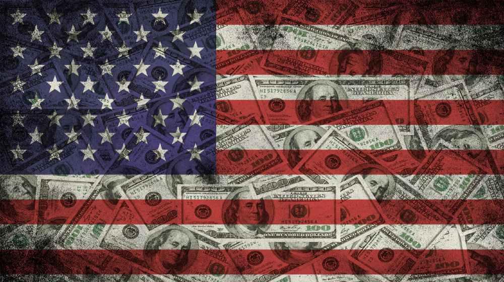Many US 100 dollars, USA flag-Dalio Advises-ss-featured