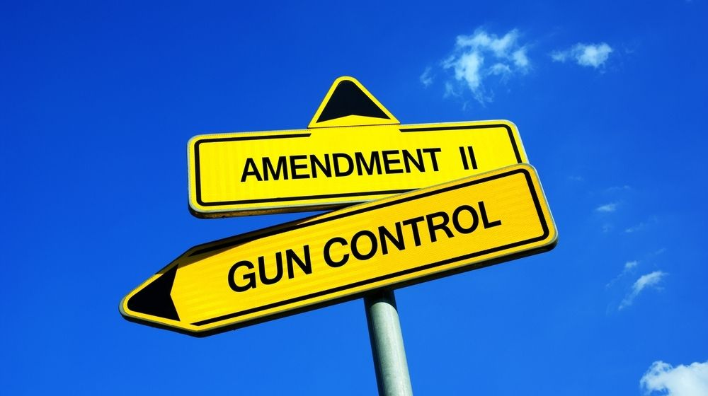 Traffic sign saying Amendment II and Gun Control-Rep. Madison Cawthorn Tells Democrats Come and Take Them After Democrat Gun Grab Proposal-ss-Featured