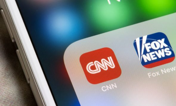 CNN and Fox News mobile app icons are seen on an iPhone. Leaning left (liberal) news versus leaning right | CNN Director Admits They Worked to 'Oust Trump' | Featured