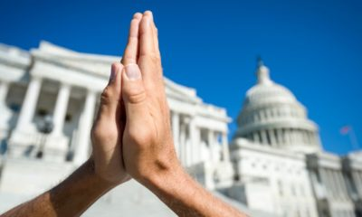 Hands held together in prayer in front on Capitol Building in Washington DC-Christian Minister-ss-featured