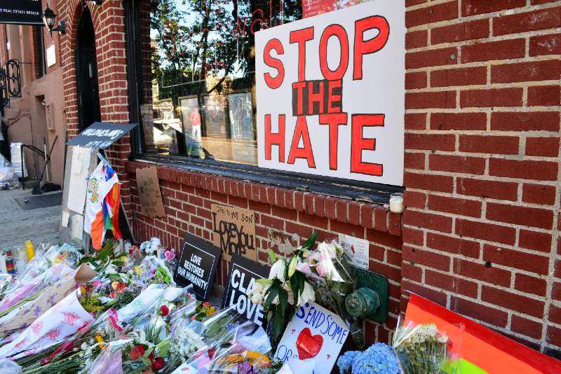 Memorial outside the landmark Stonewall Inn for the victims of the mass shooting in Orlando-Denying-ss