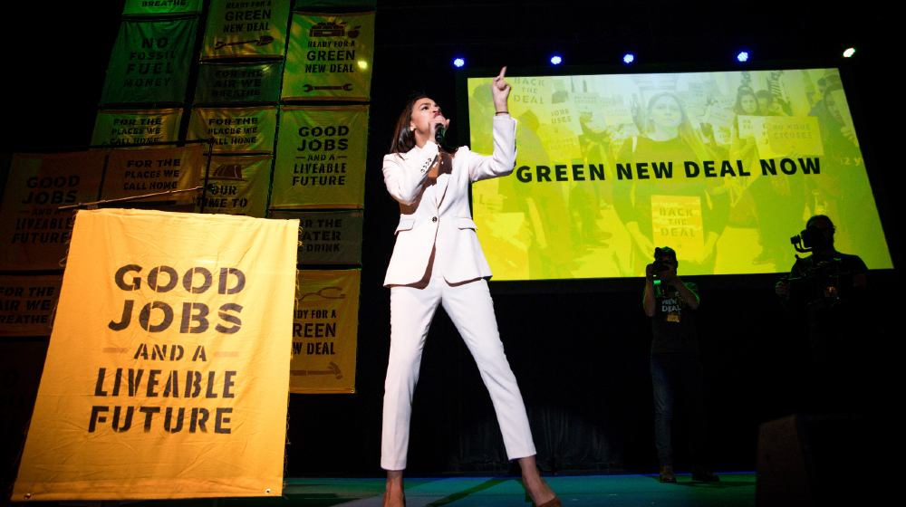 Senator Bernie Sanders and Representative Alexandria Ocasio Cortez speak about the importance of a Green New Deal-Green New Deal Debate   Rep. Taylor-Greene Challenges AOC to Green New Deal Debate   Rep. Taylor-Greene Challenges AOC to Green New Deal Debate   Featured