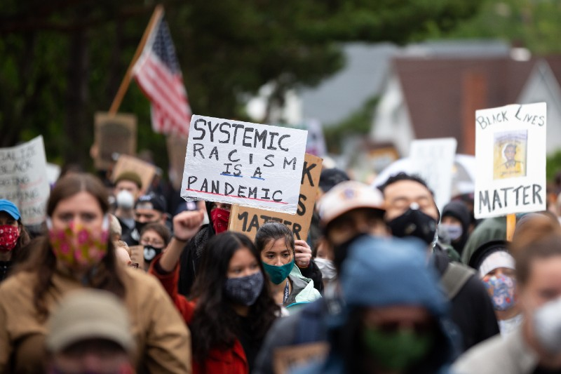 Systemic Racism is a Pandemic sign at the March of Silence, during the COVID-19 outbreak-denying-ss