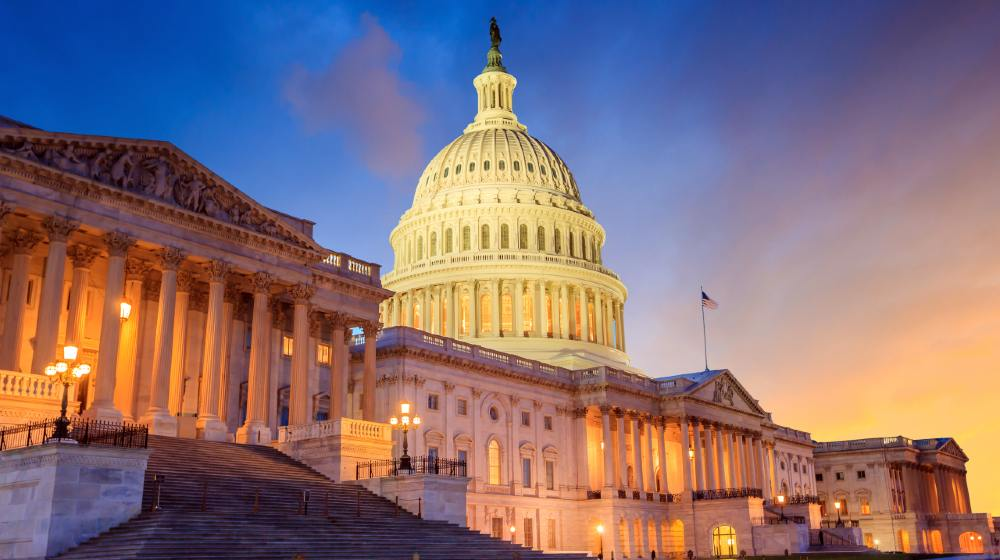 The United States Capitol building with the dome lit up at night-Point Counter Point-featured