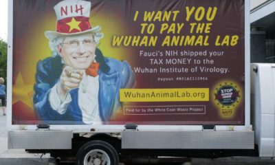 A truck feature a likeness of Dr. Anthony Fauci as Uncle Sam and questioning his supposed expenditures through the NIH   Fauci Should Resign Now For His COVID-19 Blunders   Featured