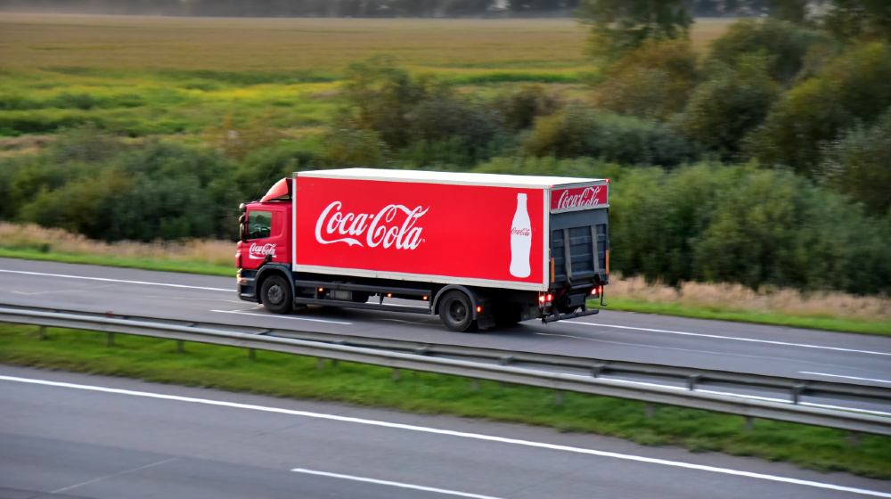 Coca Cola Truck with driving along highway | Surry County Not Sorry For Banning Coke In Govt Offices | featured