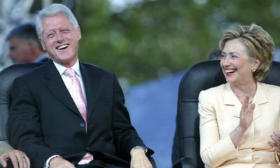 President Bill Clinton (L) and his wife, U.S. Senator Hillary Clinton (D-NY), laugh at the Greater New York Billy Graham Crusade | Reporter Who Broke Clinton Tarmac Meeting Found Dead | featured