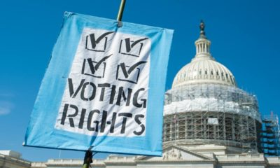 Sign supporting voting rights at the U.S. Capitol | Biden Puts Harris In Charge Of Protecting Voting Rights | Featured