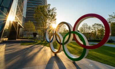The five ring symbol of the Olympic Games at tokyo museum with sun light and flare | Tokyo Olympics Covid spike | featured