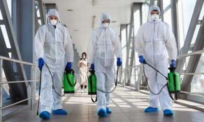 Specialist in hazmat suits cleaning disinfecting coronavirus cells epidemic, pandemic health risk | The Current Phase Of This Pandemic | featured