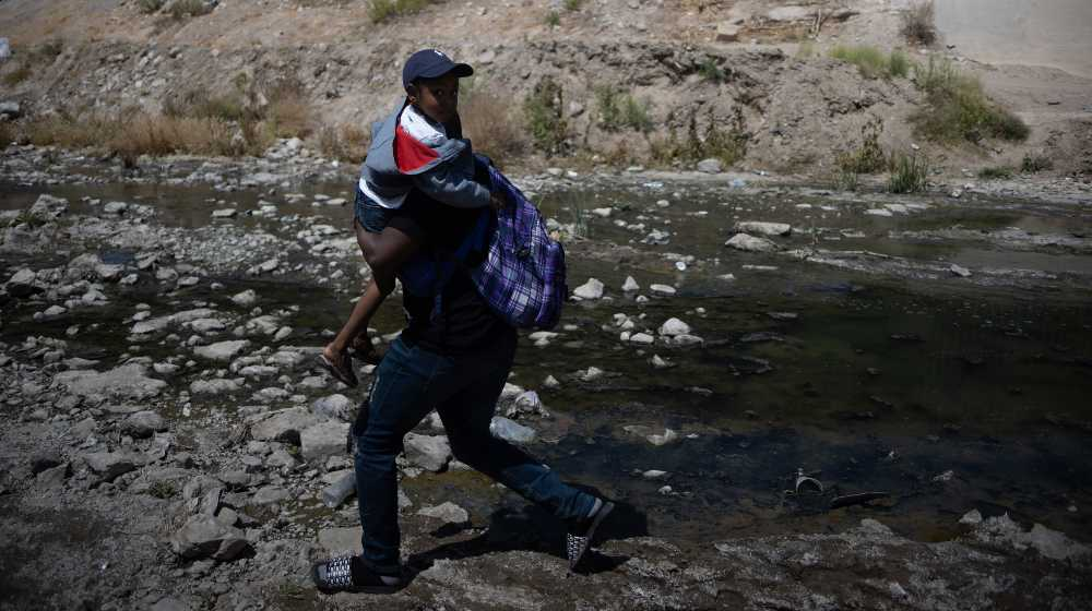 a group of 25 immigrants from Haiti crossed the Rio Grande natural border between Mexico and the United States   DHS Admits 70% of Haitian Migrants Already Released in US   featured