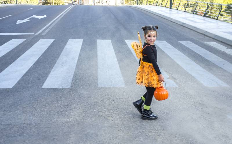 Little girl at zebra crossing in halloween costumes-Trick Or Treating